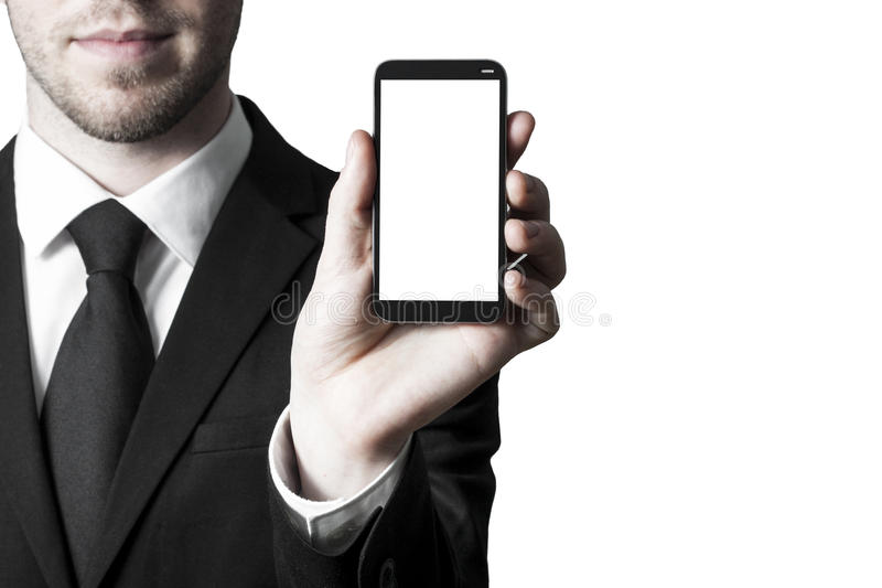 Smartphone white display. Man in suite holding smartphone with white blank display stock image