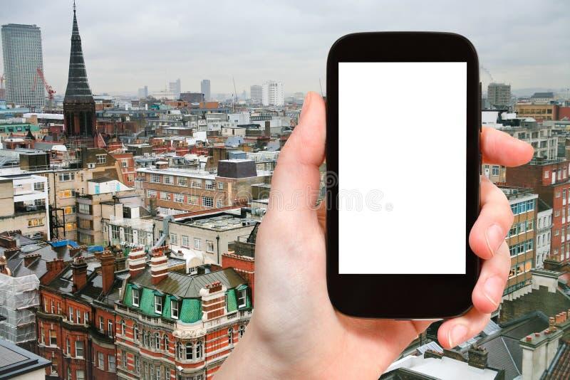 Smartphone z cięcia out parawanową i Londyńską linią horyzontu zdjęcie royalty free