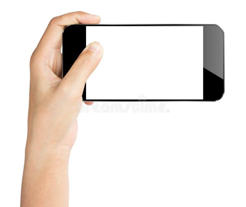 Smartphonen för Closeuphandhållen isolerade den vita snabba banan inom arkivbild