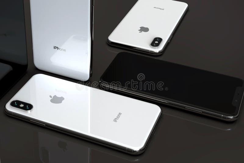 Smartphones argentés d'IPhone XS, disposés en composition en mosaïque photo libre de droits