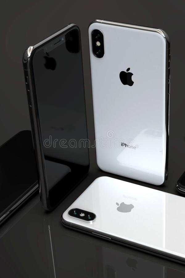 Smartphones argentés d'IPhone XS, disposés sur la table photos libres de droits