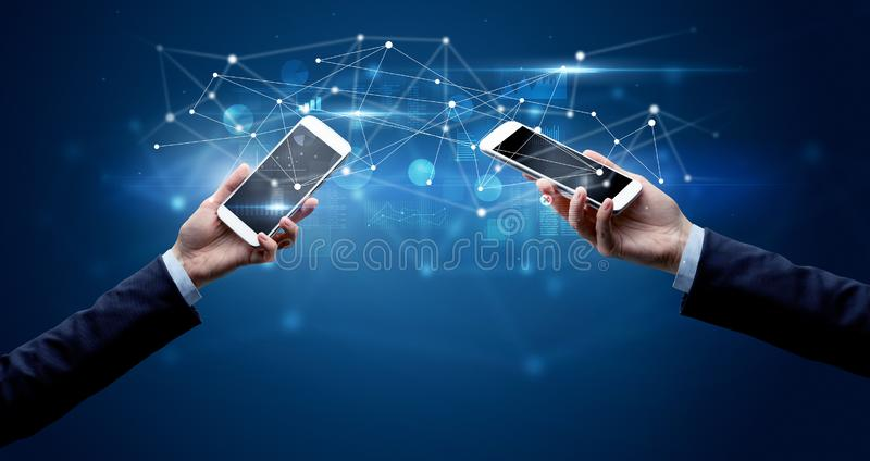 Smartphones sharing business data stock images