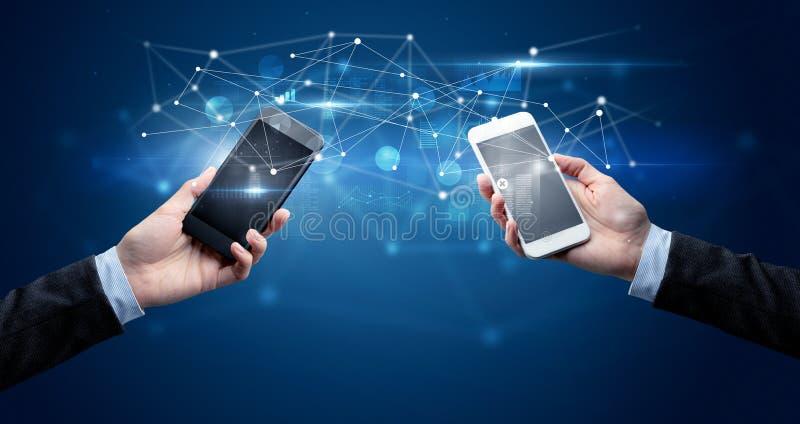 Smartphones sharing business data stock image
