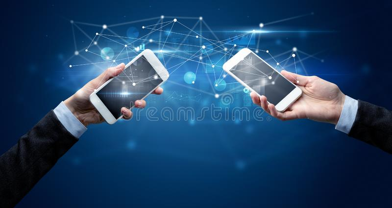 Smartphones sharing business data royalty free stock photography