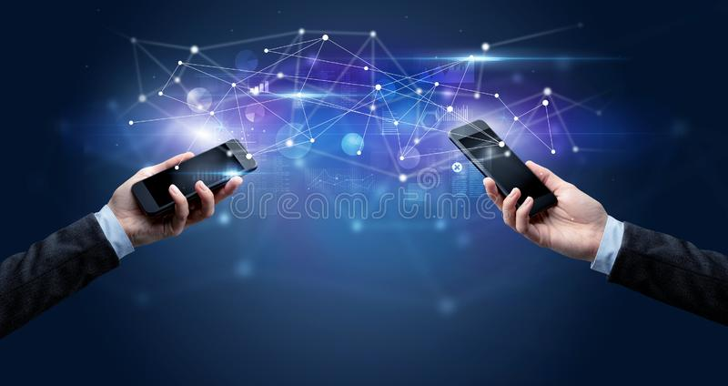 Smartphones sharing business data royalty free stock image