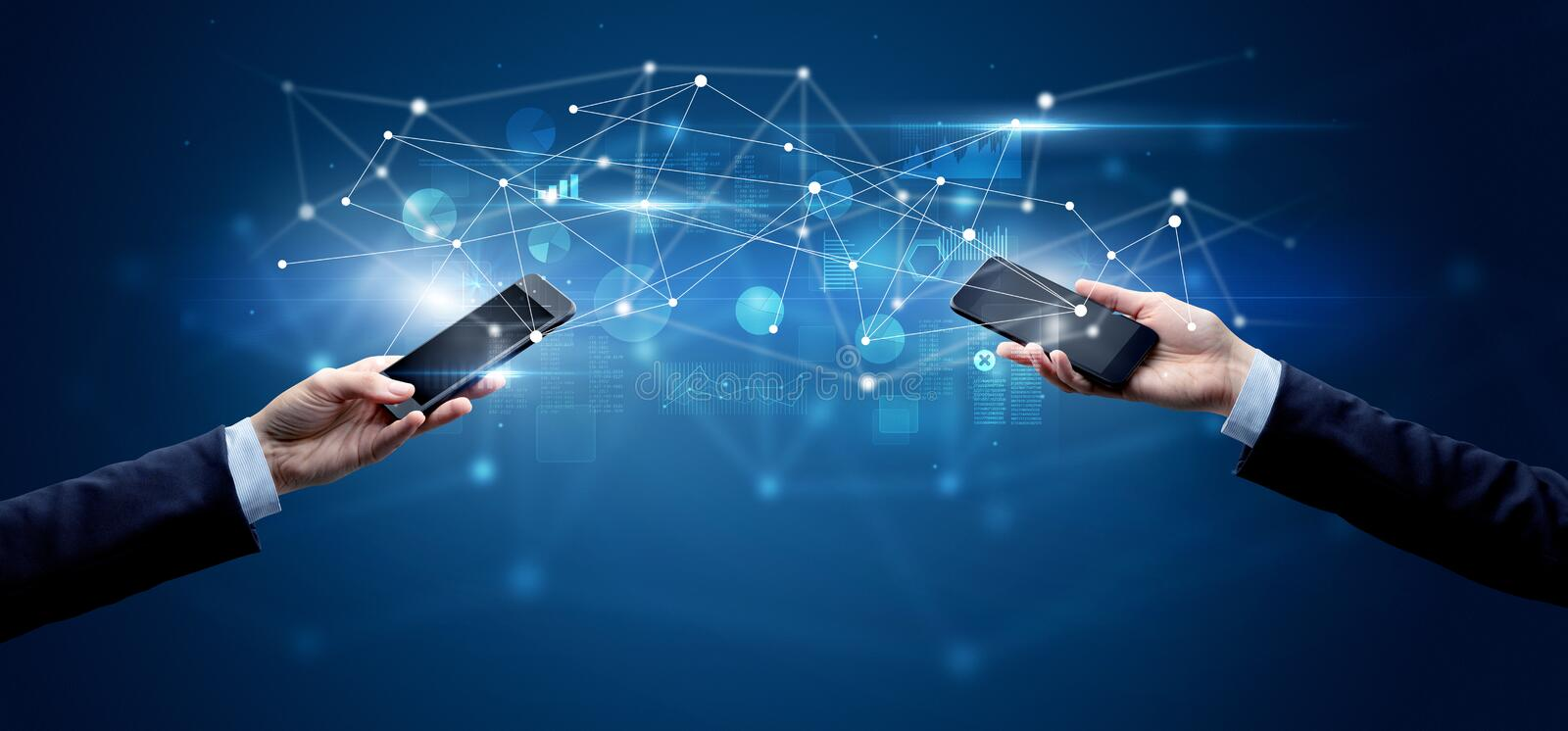 Smartphones sharing business data. Close up of two hands holding smartphones and sharing business data stock image