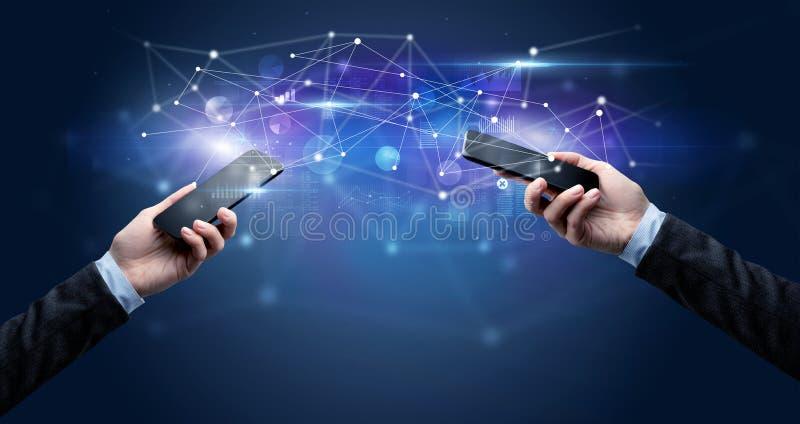 Smartphones sharing business data royalty free stock photo