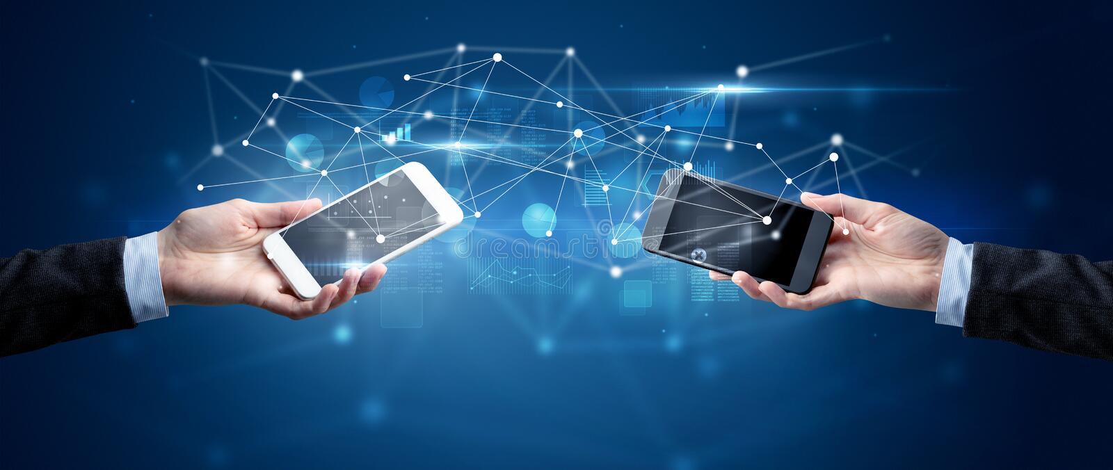Smartphones sharing business data stock photography