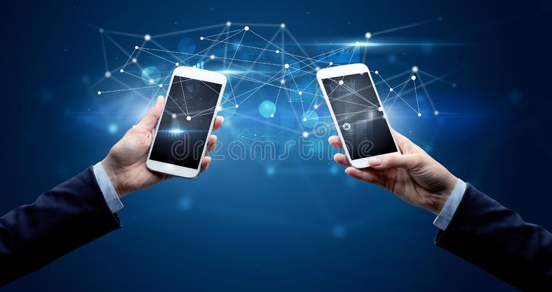 Smartphones sharing business data royalty free stock photos
