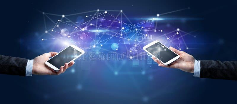 Smartphones sharing business data stock photo
