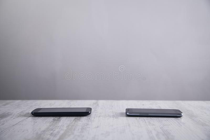 Smartphones on white modern desk stock photos