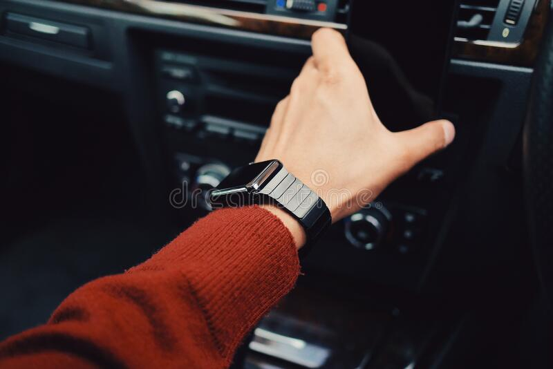 Smartwatch on arm stock images