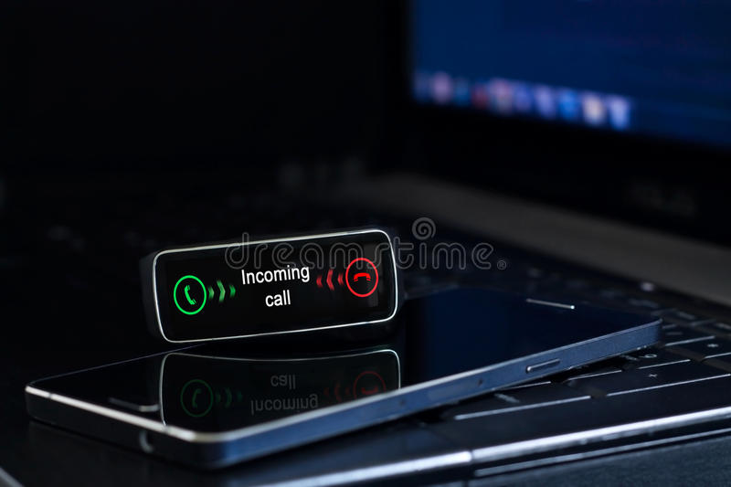 Smartwatch with incoming call notification on the display. Interface on watch screen was generated in graphical program stock photography