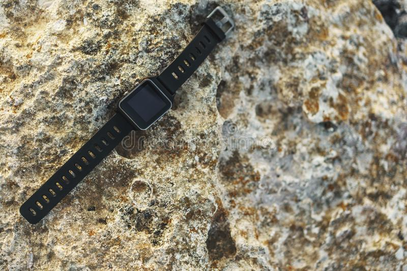Smartwatch on rock. A smartwatch on a rock at a beach in Cyprus royalty free stock photo