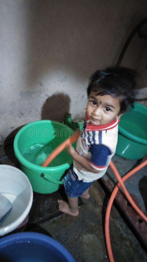 Smarty child filling water royalty free stock photography