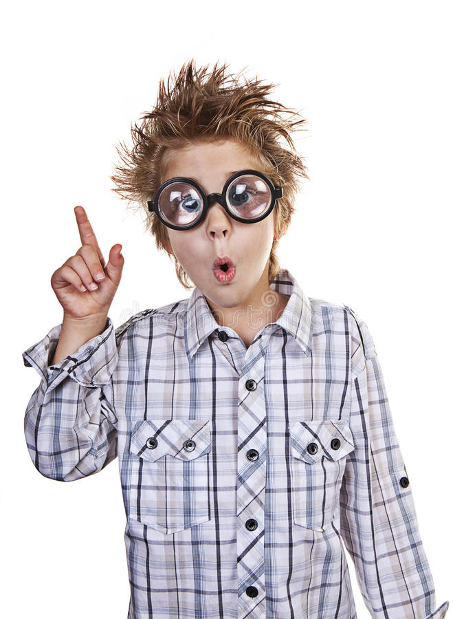Smarty Pants. Boy with very thick glasses, looks like he's made a breakthrough on a problem stock photos