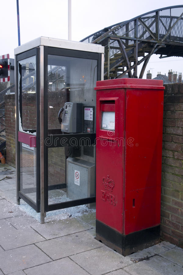 Smashed Broken Phone Box in Wokingham. A Smashed Broken Phone Box in Wokingham stock image