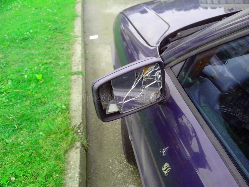 Smashed car. Mirror. Audi 80 stock images