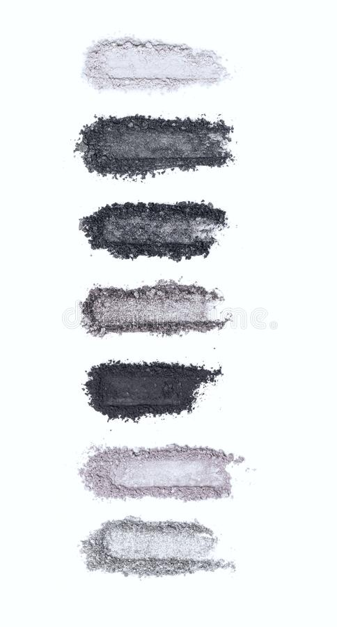 A smashed, gray toned eyeshadow make up palette isolated on a white background stock photos