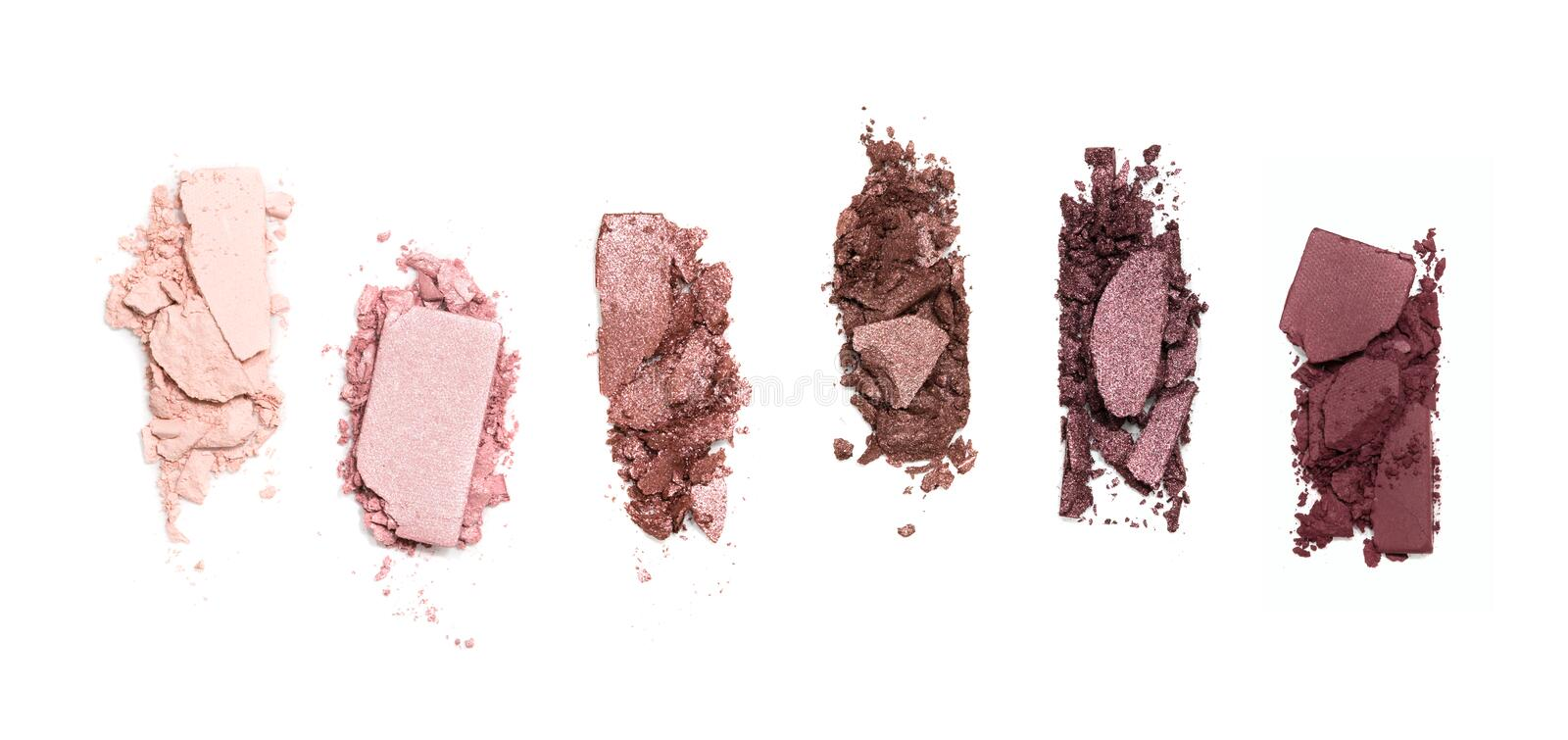 A smashed, neutral toned eyeshadow make up palette isolated on a white background stock images