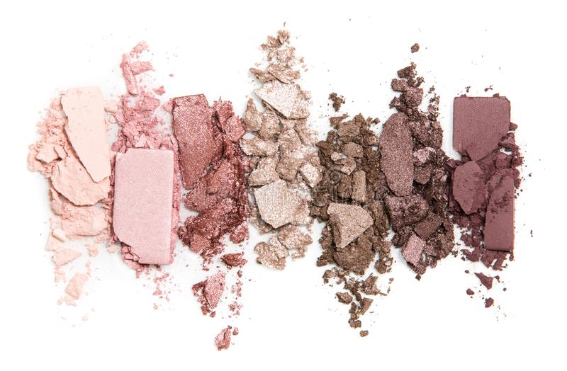 A smashed, neutral toned eyeshadow make up palette isolated on a white background royalty free stock images
