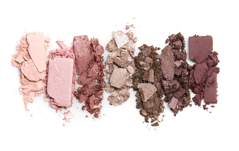 A smashed, neutral toned eyeshadow make up palette isolated on a white background stock photo