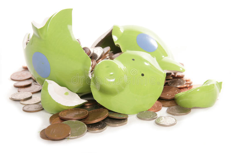 Smashed Piggy Bank With British Currency Coins Stock Image