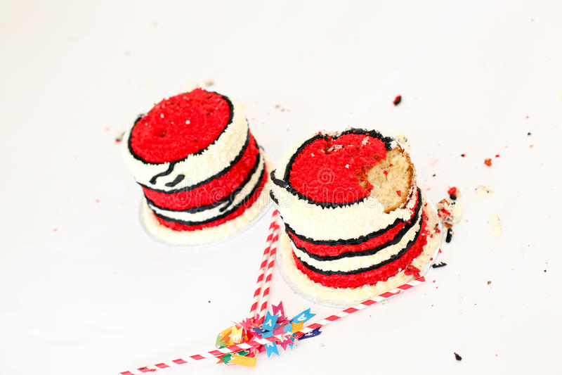 Smashed up birthday cakes. To celebrate first year twin babies royalty free stock photography