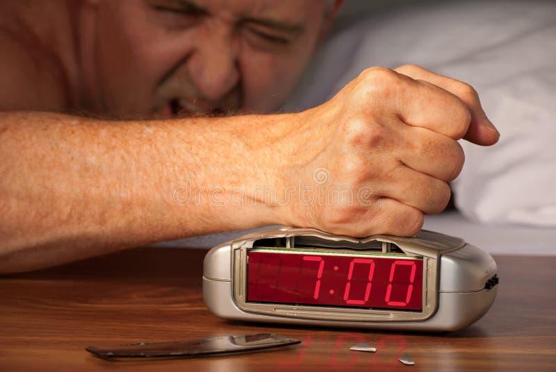 Smashing alarm clock at 7:00 a.m. royalty free stock photography