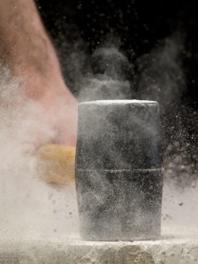 Smashing The Stone Stock Photo