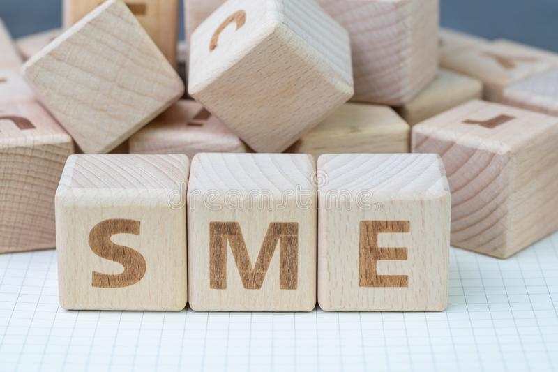 SME, small and medium-sized enterprises concept, cube wooden block with alphabet combine the word SME, entrepreneur business stock image