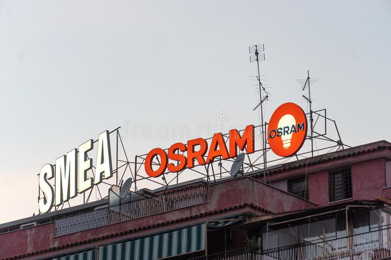 Smea and Osram signage on the top of a building. Rome, Italy - August 8, 2018: Smea and Osram signage. SMEA is an Italian company providing electrical and royalty free stock photo