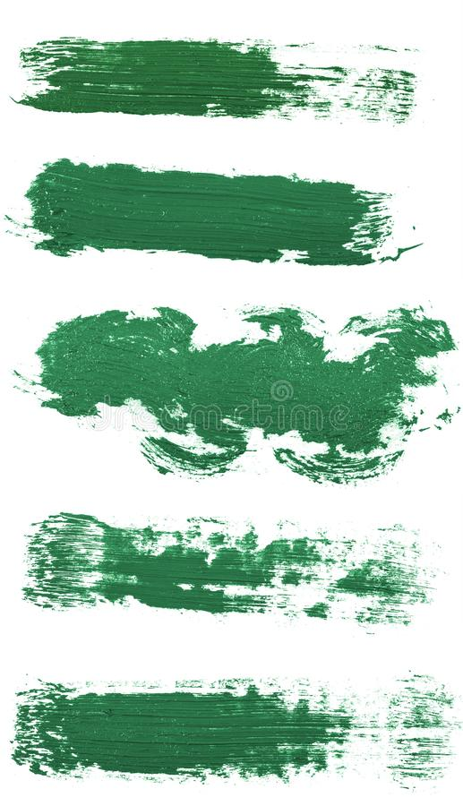 Smear of green paint isolated on white. Set. Smear of green paint isolated on white background. Set royalty free stock photography