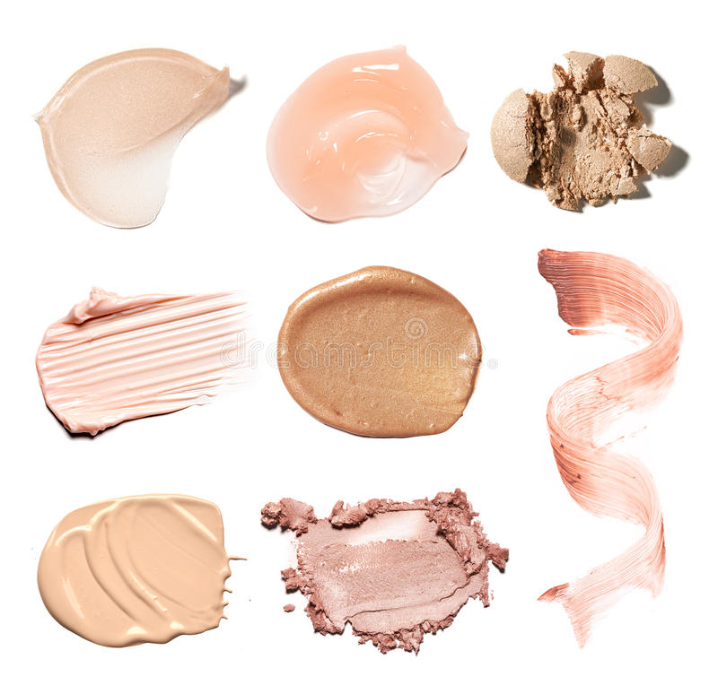 Smear paint of cosmetic products. On a white background royalty free stock photo