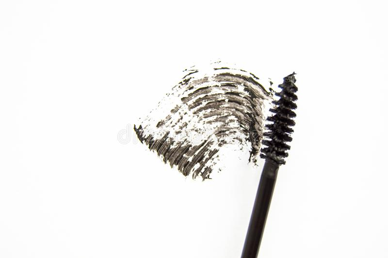 Smear and texture of black mascara isolated on white background with mascara brush stock images