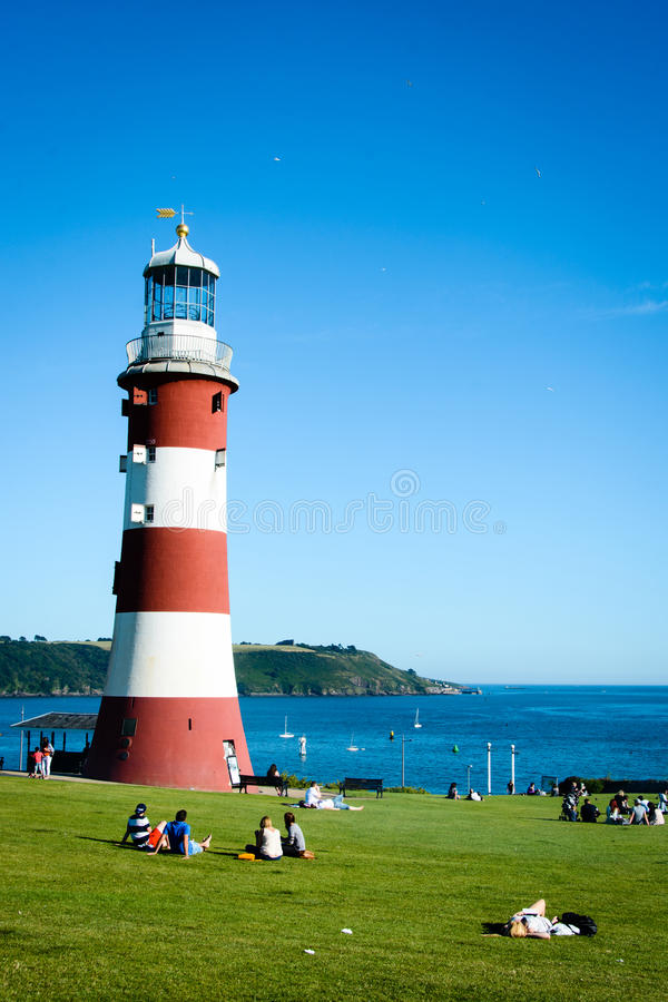 Smeaton's Light Tower, Plymouth (portrait mode). The red and white striped light tower stands at the Hoe Park in Plymouth - a popular place for relaxing, walking stock images
