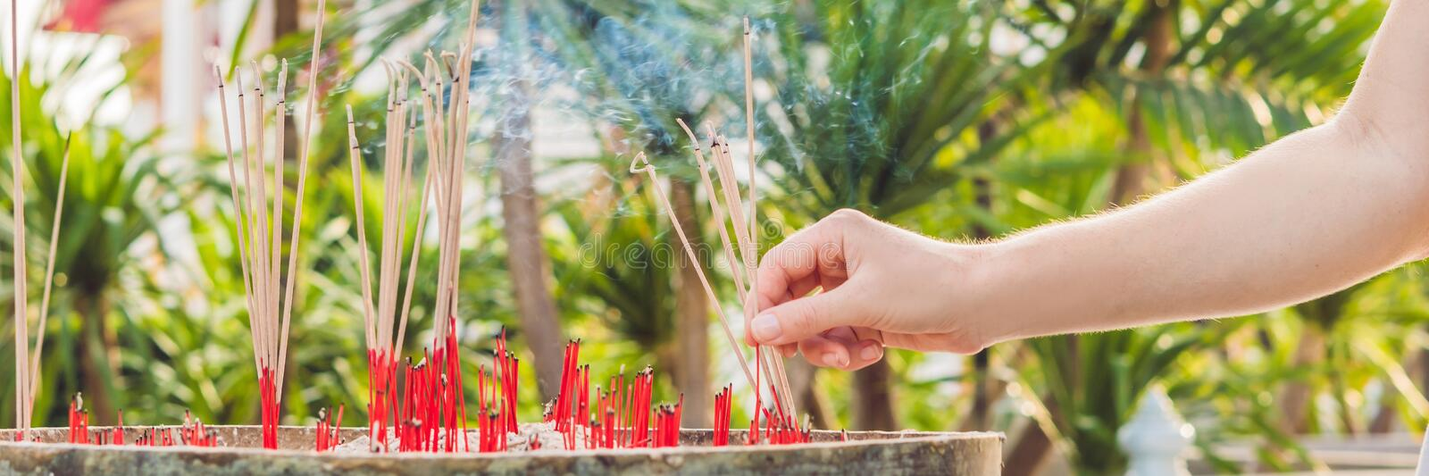 Smell the smoke of Incense, The smoke of joss stick in temple, smoke of incense in the spirit shrine BANNER, long format stock photos