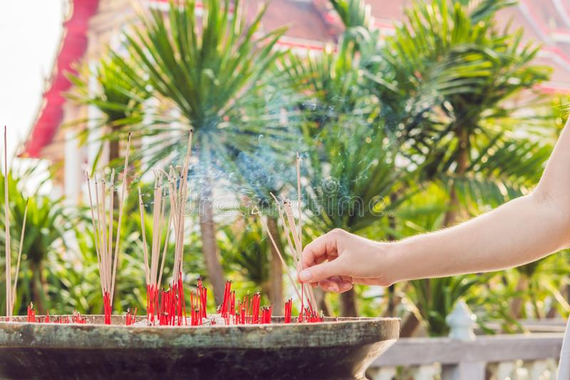 Smell the smoke of Incense, The smoke of joss stick in temple, smoke of incense in the spirit shrine royalty free stock photography