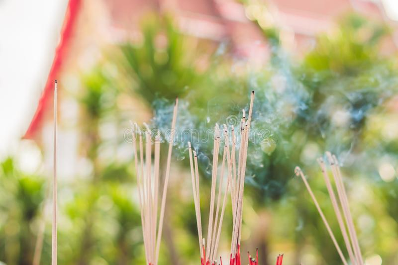 Smell the smoke of Incense, The smoke of joss stick in temple, smoke of incense in the spirit shrine royalty free stock images