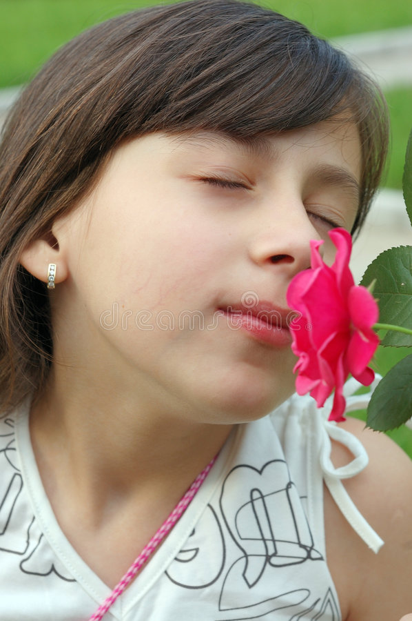 Smelling flower royalty free stock images