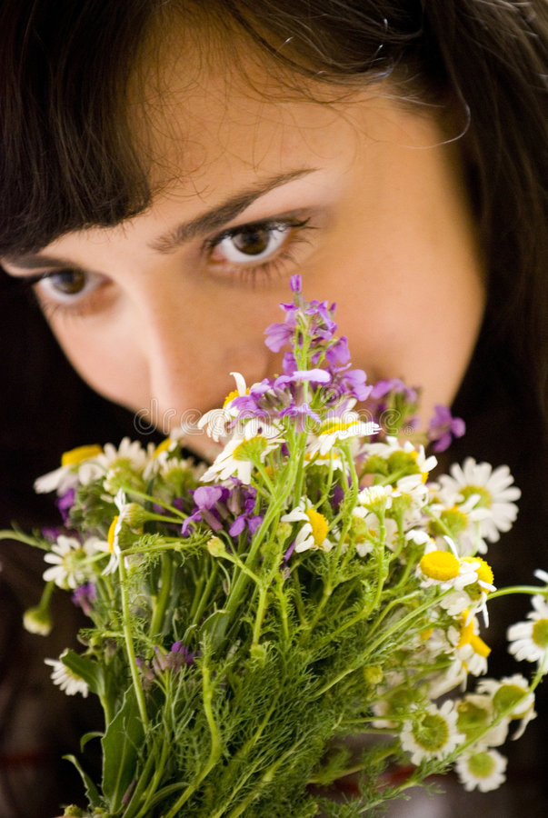 Smelling the flowers royalty free stock photography