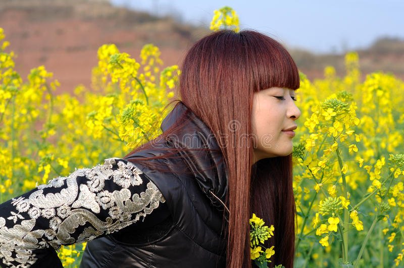 Smelling Flowers Stock Photography