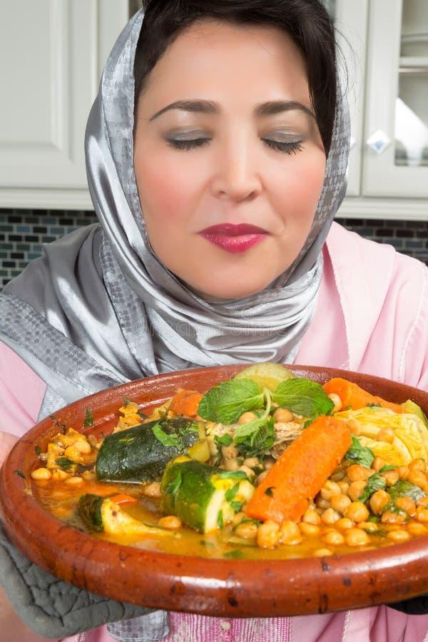 Smelling Moroccan spices stock photos