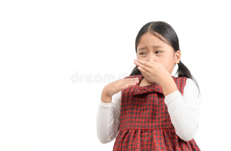 Cute asian girl  squeezing nose with fingers with disgust expression stock photos