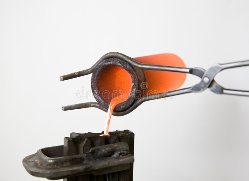 Smeltend metaal stock afbeelding