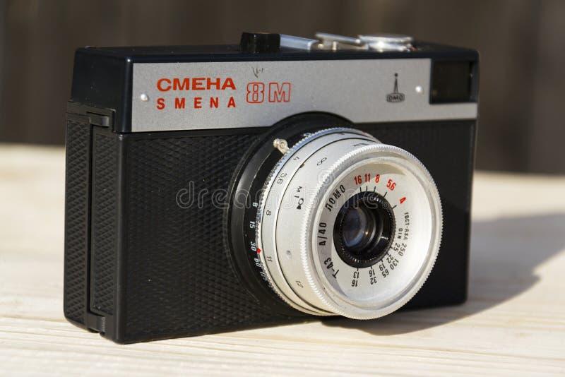 Smena 8M old vintage filtered camera on wooden background stock image