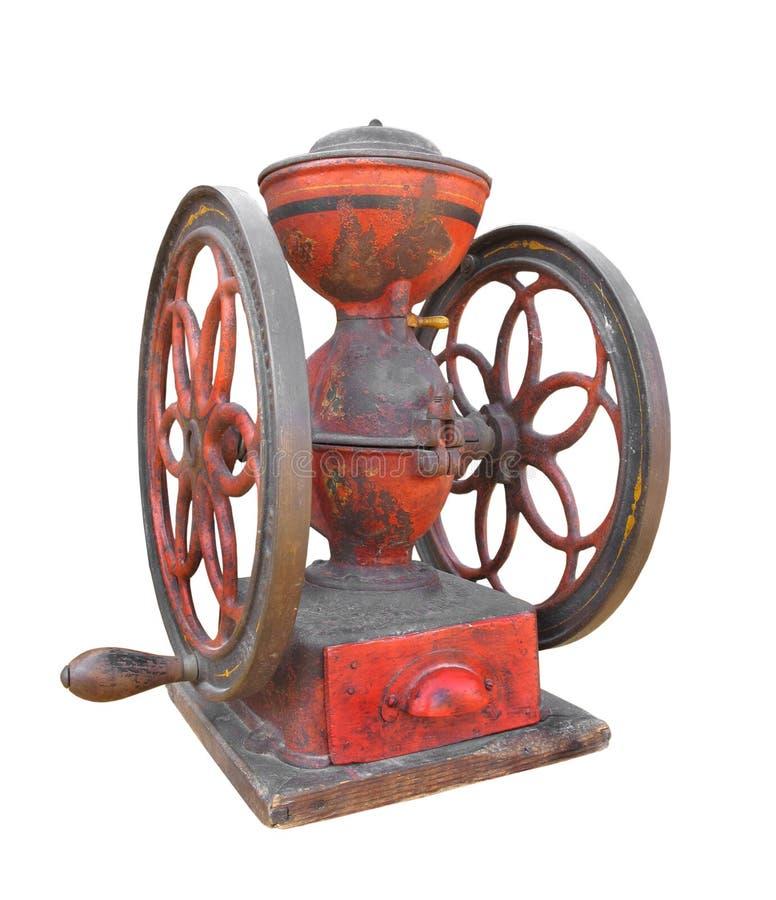 Smerigliatrice di caffè antica del metallo isolata. immagine stock libera da diritti