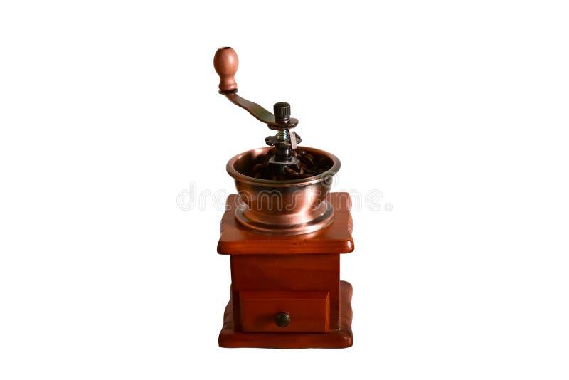 Smerigliatrice di legno manuale del mulino di caffè isolata su fondo bianco fotografia stock
