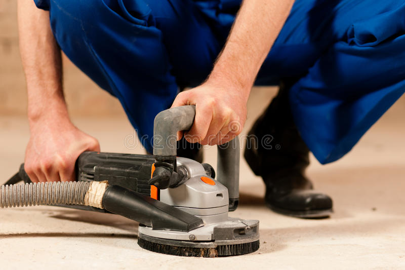 Smeriglitatura del pavimento del cemento fotografie stock libere da diritti