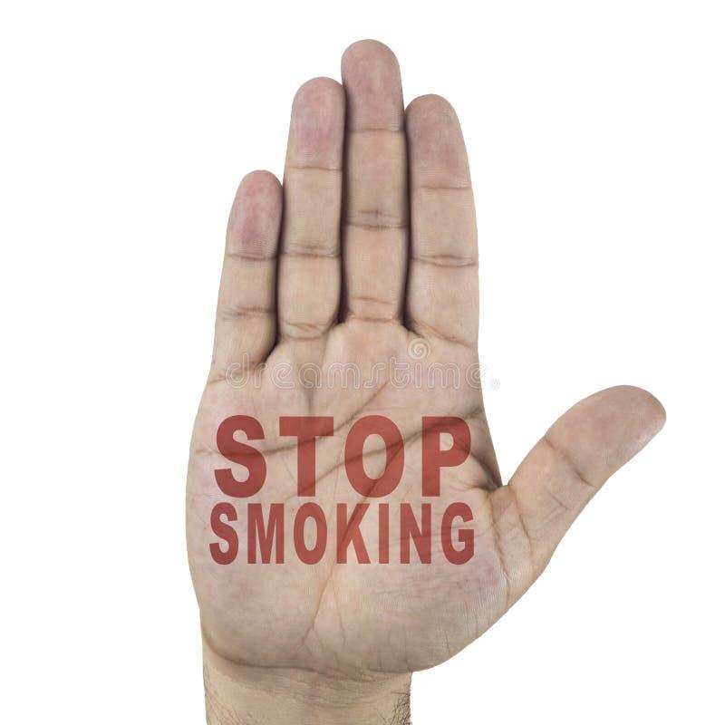 Smetta di fumare le parole scritte sulla mano maschio del ` s Isolato su priorità bassa bianca immagini stock libere da diritti